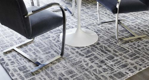 Contemporary-style rug under modern chairs and a table