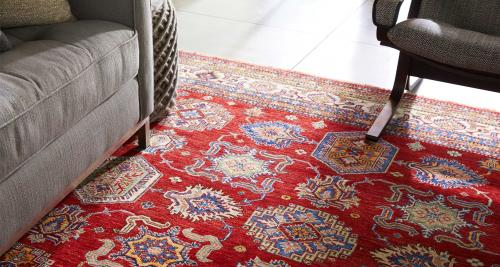 Traditional-style rug under a sofa leg and chair leg
