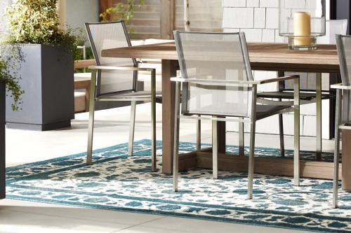 Dining table and chairs on a rug