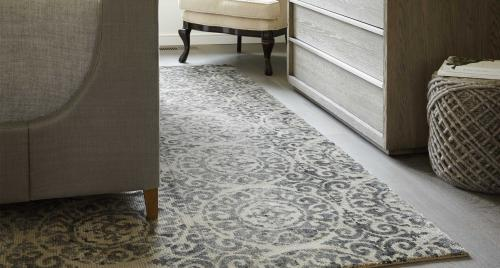 Transitional-style rug under and between furniture